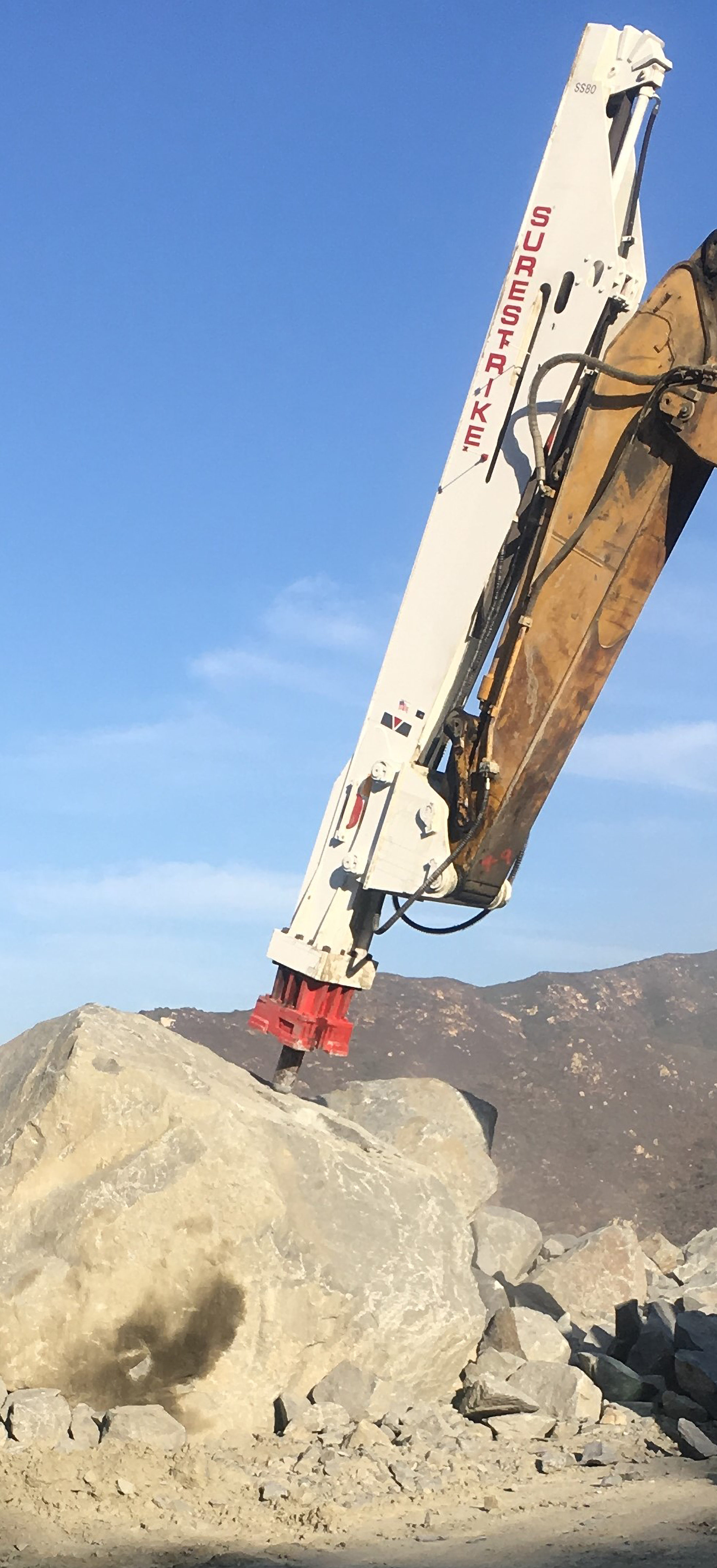 SS80 on CAT 385 Breaking Granite large